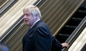 Boris Johnson  on an escalator