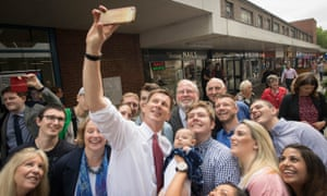 Jeremy Hunt takes a selfie with supporters during a visit to Chelsmford town centre in Essex today.