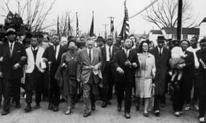 Luther King Marches<br>30th March 1965:  American civil rights campaigner Martin Luther King (1929  - 1968) and his wife Coretta Scott King lead a black voting rights march from Selma, Alabama, to the state capital in Montgomery.  (Photo by William Lovelace/Express/Getty Images) white;format landscape;Personality;Marches Demonstrations;American;North America;EXP 34A;ES LUTHER;
