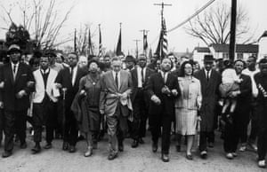 Coretta Scott King and her husband lead a black voting rights march from Selma, Alabama.