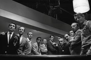 The cast of Ocean's 11, 1960. (From left) Nick Conti, Jerry Lester, Joey Bishop, Sammy Davis Jr, Frank Sinatra, Dean Martin, Peter Lawford, Akim Tameroff, Richard Benedict, Henry Silva, Norman Fell and Clem Harvey.