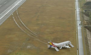 An Asiana Airlines airplane that skidded off the runway after landing at Hiroshima airport in Mihara, western Japan.