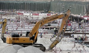 Workers at the Al-Wakrah stadium in Doha use heavy machinery during preparations for the 2022 World Cup in Qatar