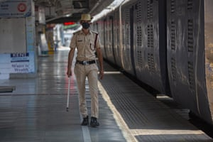 A security officer keeps vigil at an empty railway station in Gauhati