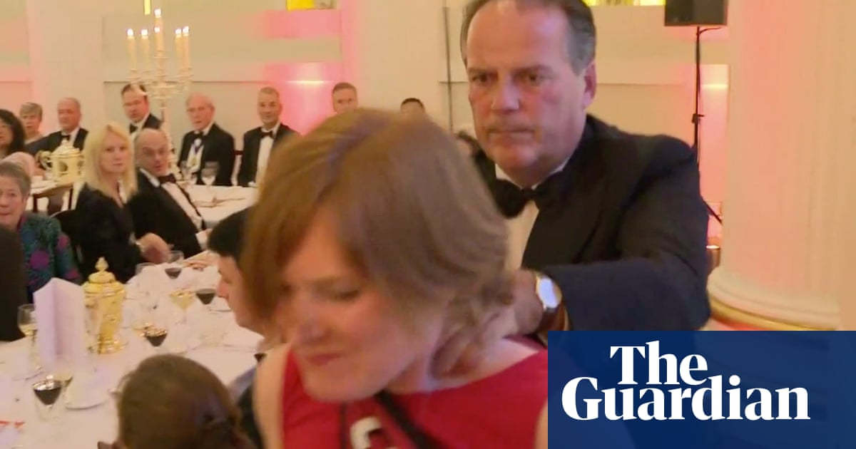 Mark Field urged to quit as minister after grabbing climate protester