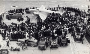 Crowd surrounding the Howard Hughes airplane at the Floyd Bennett airport, New York.