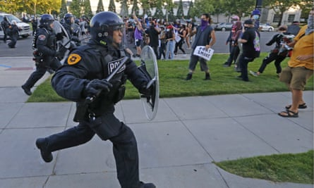 A Salt Lake City police officer at a protest earlier in July. Police foundations – which provide funds to local police departments – in cities such as Salt Lake are partially funded by corporate names.