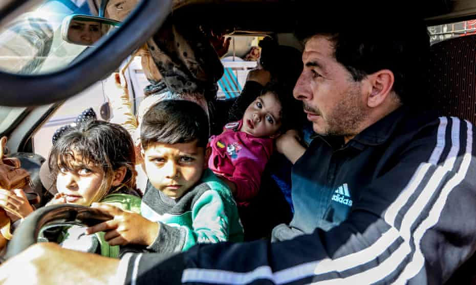 Mohammed Rahman, from Flita, leaves Lebanon with his family to return to Syria.