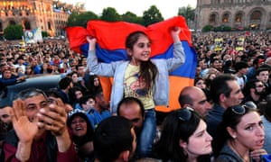 Supporters of Armenia's protest leader Nikol Pashinyan attend a rally in downtown Yerevan