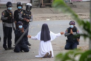 A nun pleads with police not to harm protesters in Myitkyina, Kachin state