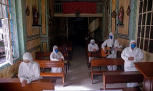 Health workers from the Portuguese charity hospital in Belem, state of Para, Brazil, play music and pray for COVID-19 patients at a chapel inside the hospital as part of Easter celebrations on April 4, 2021.