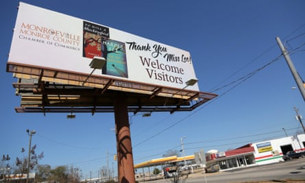 a billboard – photographed soon after Lee's death in February 2016 – welcomes visitors to Monroeville.