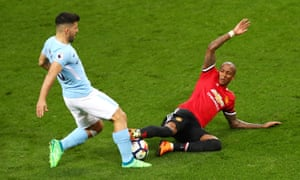 Ashley Young plants his studs on Sergio Agüero's shin but Manchester City's furious penalty claims fell on deaf ears.