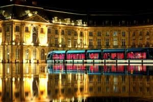 A late night tram in front of Bordeaux Palais de la Bourse.