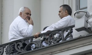 Iran's foreign minister, Mohammad Javad Zarif (l) takes a break from the negotiations at the Palais Coburg hotel, in Vienna.