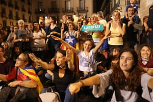 People with estelada flags gather in front of the Palau de la Generalitat de Catalunya, which houses the Catalan presidency