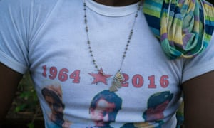 A guerrilla fighter wears T-shirt depicting Farc commanders and their 52-year struggle.