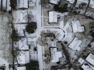 Homes in the Westbury neighborhood are covered in snow in Houston, 15 February 2021.