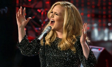 Adele performing Skyfall: The singer says her pregnancy helped her hit the low notes in the James Bond theme song.