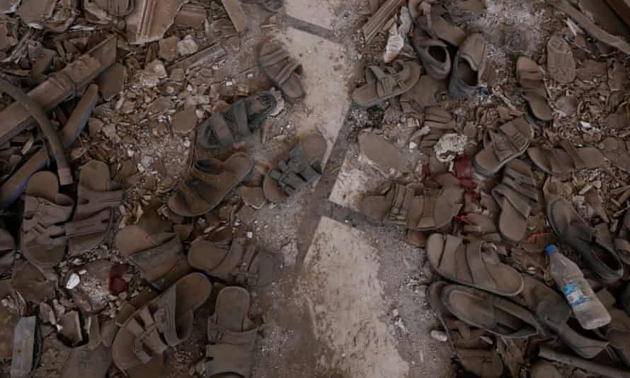 Shoes and slippers belonging to victims of a Saudi-led airstrike at a mourning ceremony in Sana'a, Yemen, in October.