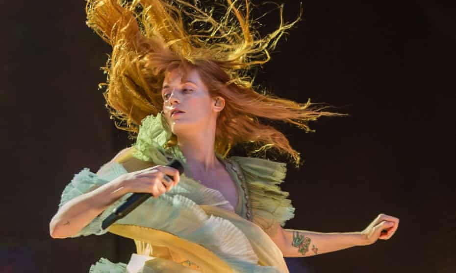 'I am still trying to understand what makes young women go to war with themselves' ... Florence Welch performing in Hyde Park, London, 13 July 2019.