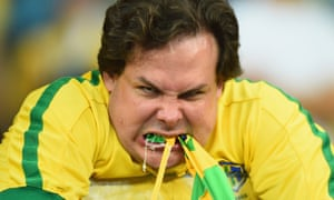 A Brazil fan reacts after their 7-1 demolition by Germany.