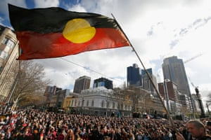The Aboriginal flag flys high over the sea of people