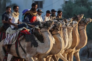 Rafa, The Gaza stripPalestinian men ride camels after taking part in a race.