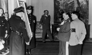 Nazi Field-Marshal Hermann Goering admires a painting given to him by Adolf Hitler, right, for his 45th birthday, 1938.
