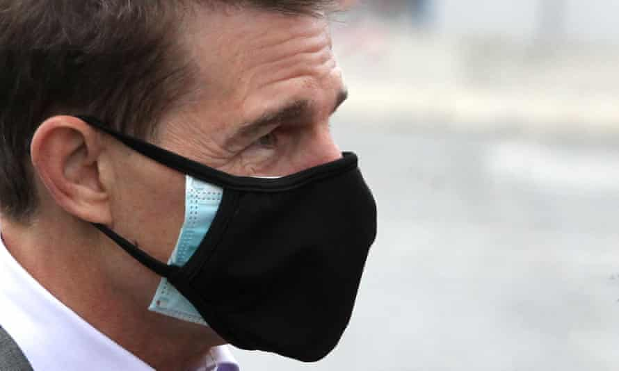 Tom Cruise wears two masks on set in Rome in November.