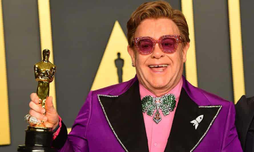 Elton John poses with the Oscar for best original song during the 92nd Academy Awards in February 2020.