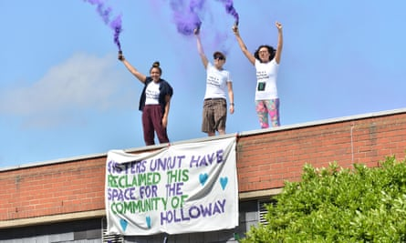 Members of Sisters Uncut protesting on top of of Holloway prison