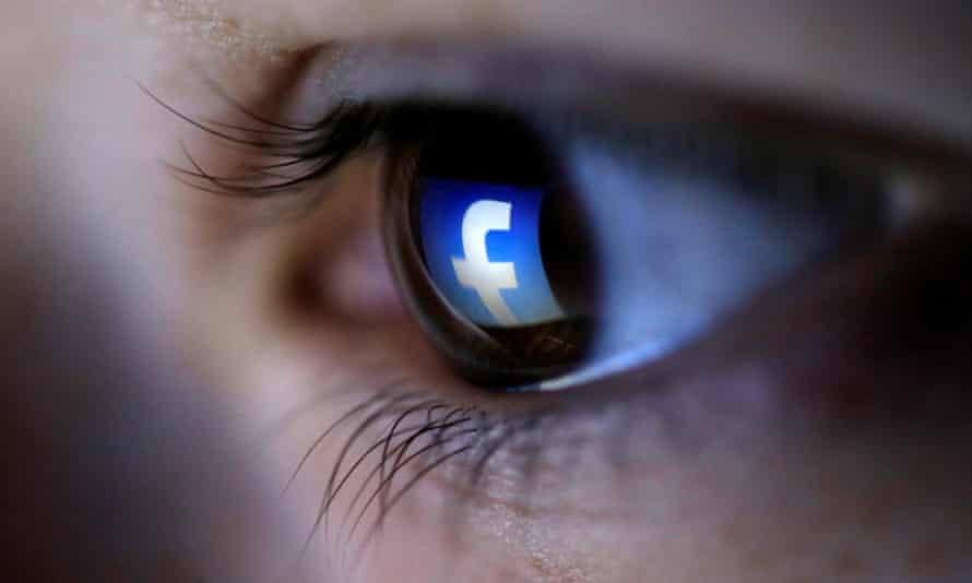 Facebook logo reflected in a person's eye