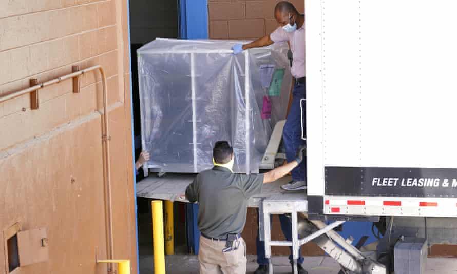 Officials unload the electoral equipment.