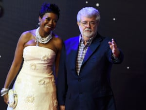 Star Wars director George Lucas and his wife Mellody Hobson arrive for the European premiere in London