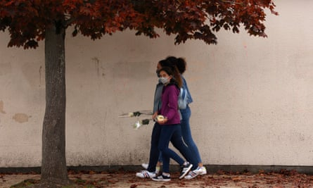 Teenagers carrying flowers to school after a teacher was beheaded in a Paris suburb