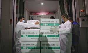 Workers transport boxes of vaccines developed by Beijing Institute of Biological Products.