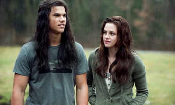 Taylor Lautner with Kristen Stewart in The Twilight Saga – New Moon, 2009.