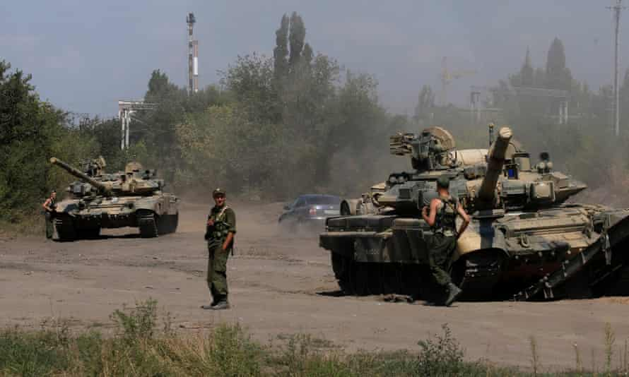Russian soldiers next to tanks in Kamensk-Shakhtinsky, Rostov region, near the border with Ukraine. The US says Russia's actions in Ukraine are 'worrisome' and pose a threat to America.