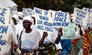 The Liberian Women Mass Actions for Peacemarching towards the ECOMIL headquarters in Monrovia