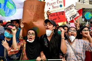 Youths hold placards as they march in Lahore