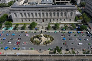 San Francisco's first sanctioned tent encampment is in a fenced-off space near city hall with spaces marked for social distancing and some amenities.