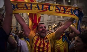 Pro-independence supporters gather in Barcelona, after Catalonia's regional parliament passed a motion to establish an independentr epublic.