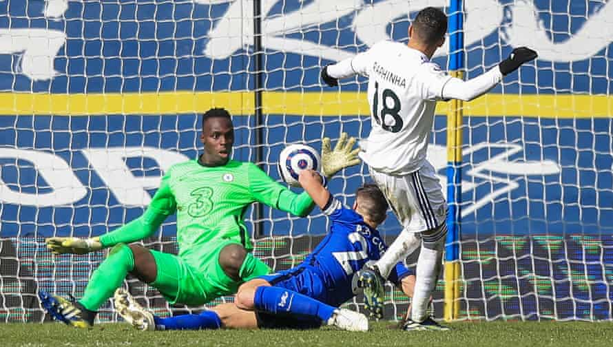 Édouard Mendy saves a shot from Leeds's Raphinha in March.