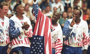 Michael Jordan flashes a victory sign as he stands with teammates Larry Bird, Scottie Pippen and Clyde Drexler after winning the Olympic gold in Barcelona