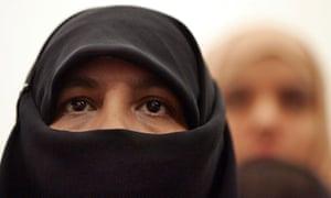 A woman wearing a full-face veil