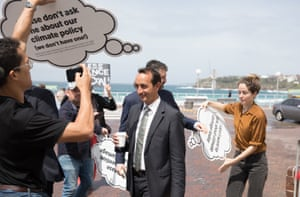 Dave Sharma is mobbed by protesters as he arrives at a candidates forum in Bondi on Monday.