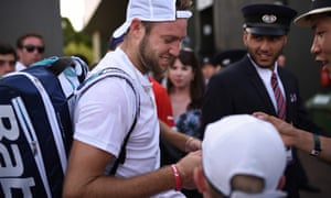 Jack Sock signs autographs after winning his men's singles first round match against Chile's Christian Garin on Tuesday.