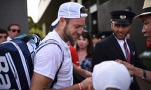 US player Jack Sock signs autographs after winning his men's singles first round match against Chile's Christian Garin.
