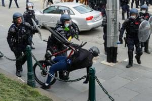 Police confront a demonstrator in Melbourne, Australia